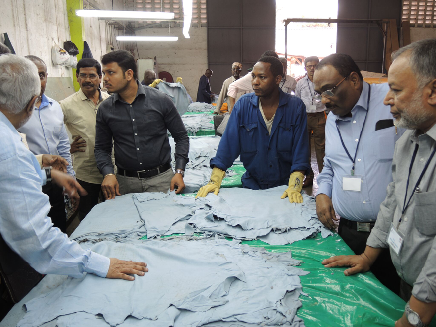 AISHTMA delegation examine wet blue leather samples during their visit to Aziz Tannery in Kenya.