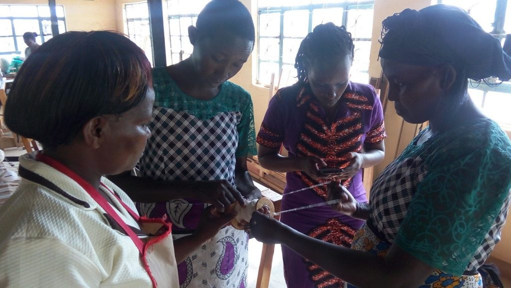 Trainers from Tosheka and Wote Development Community Association examine the yarn spun by the trainees